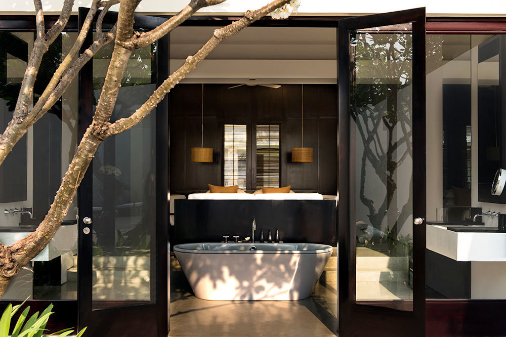 The Pool Suite with french doors opening to the bath tub at Amansara in Cambodia