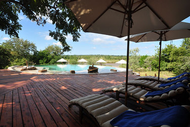 Lounge chairs on the pool deck at Azura Selous in the Selous Game Reserve, Tanzania