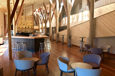 The hotel's interior and the bar at explora Valle Sagrado in the Sacred Valley, Peru