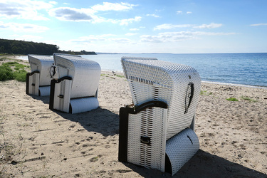 The beach with private Strandkörbe (hooded beach chairs) at Weissenhaus Grand Village Resort in Weissenhaus, Germany