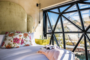 The bed and view of the Family Suite at The Silo in Cape Town, South Africa