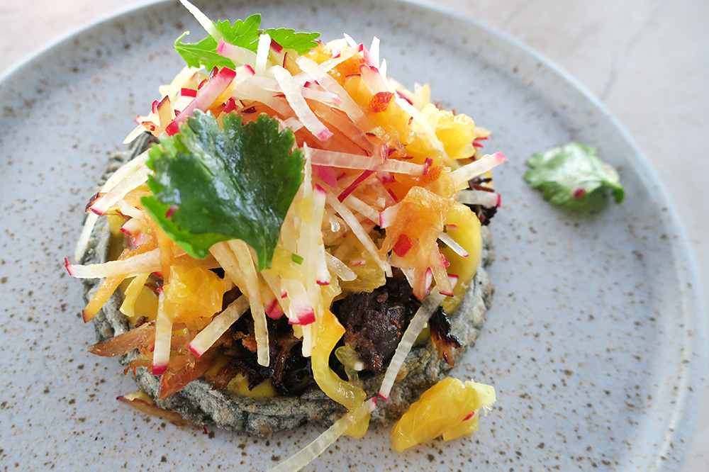 Blue-corn sope topped with duck confit from COMAL at Chileno Bay Resort in Los Cabos, Mexico