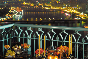 Nighttime balcony views of the Nile River at Four Seasons at Nile Plaza in Cairo, Egypt