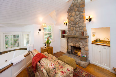 Plumstead Cottage living room with tub and fireplace at Simpson House Inn in Santa Barbara, California