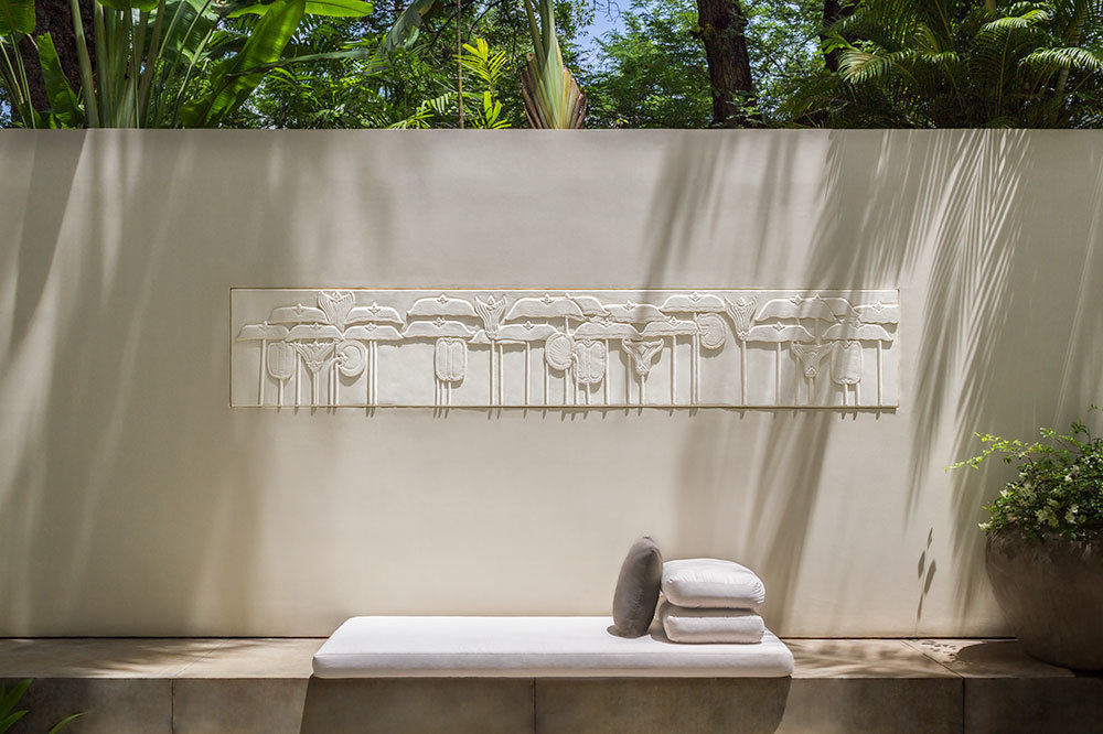 The Courtyard Suite with modern floral relief wall art at Amansara in Cambodia