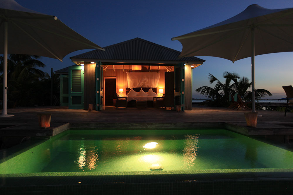Casa Solana with private infinity pool at sundown at Cayo Espanto in Belize