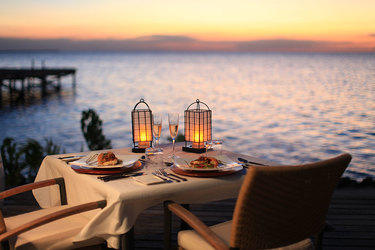 Dining at sunset along the sea at Cayo Espanto in Belize