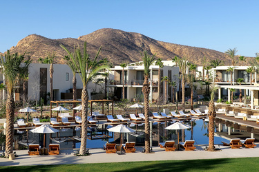 The pool and building exteriors of Chileno Bay Resort in Los Cabos, Mexico