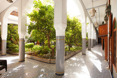Courtyard with tiled columns at the Palais Amani Hotel in Fez, Morocco