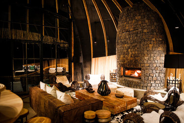 Seating by the fireplace in a common area at Bisate Lodge in Ruhengeri, Rwanda