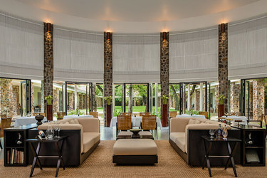 Dining room looking onto a green courtyard at Amansara in Cambodia