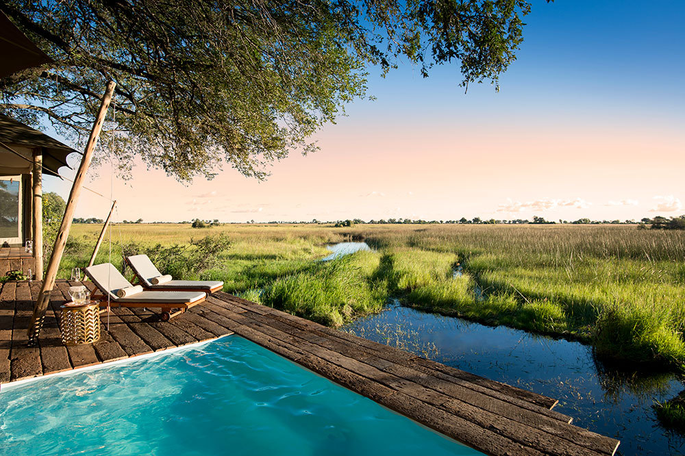 The view from a guest tent's pool and deck at Duba Plains Camp in Duba Plains Reserve, Botswana