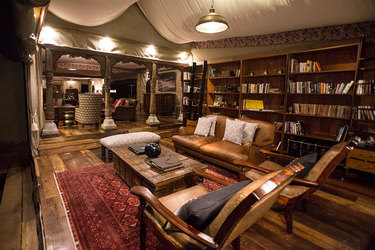 The library of a main area at Duba Plains Camp in Duba Plains Reserve, Botswana