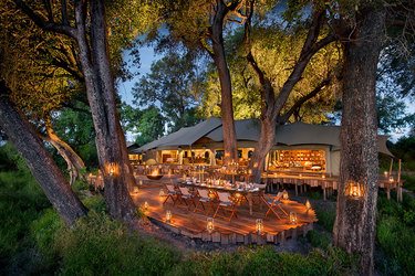 The exterior and dining area of the main tent at Duba Plains Camp in Duba Plains Reserve, Botswana