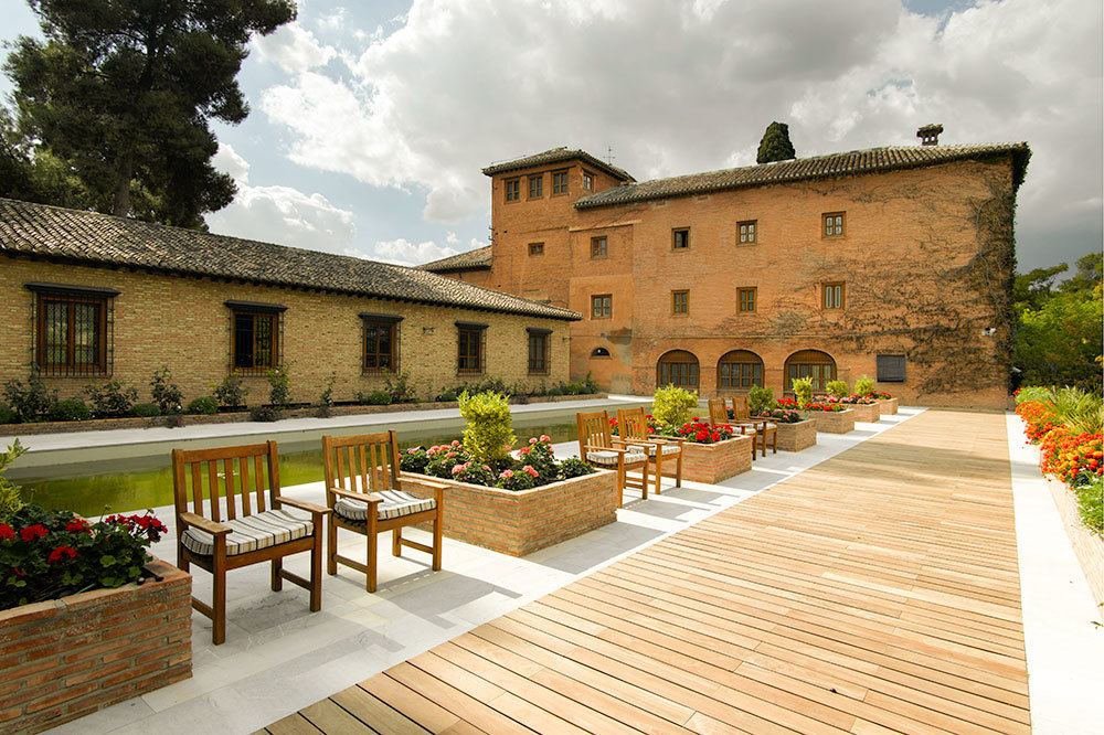 Ivy covered facade and boardwalk at Parador de Granada in Andalusia, Spain