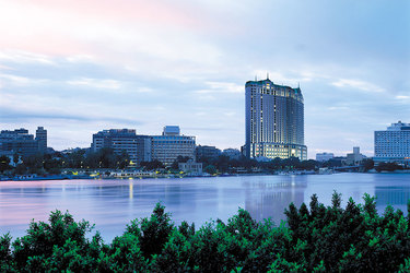 Exterior of Four Seasons at Nile Plaza stands tall against the horizon in Cairo, Egypt