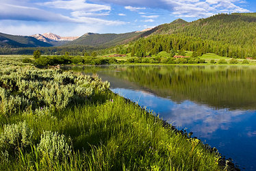 Firehole Ranch nestled in the mountainscape and Hebgen Lake in Western Yellowstone, Montana