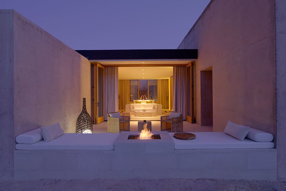 The desert lounge with fire pit in the Girijaala Suite at Amangiri in Canyon Point, Utah