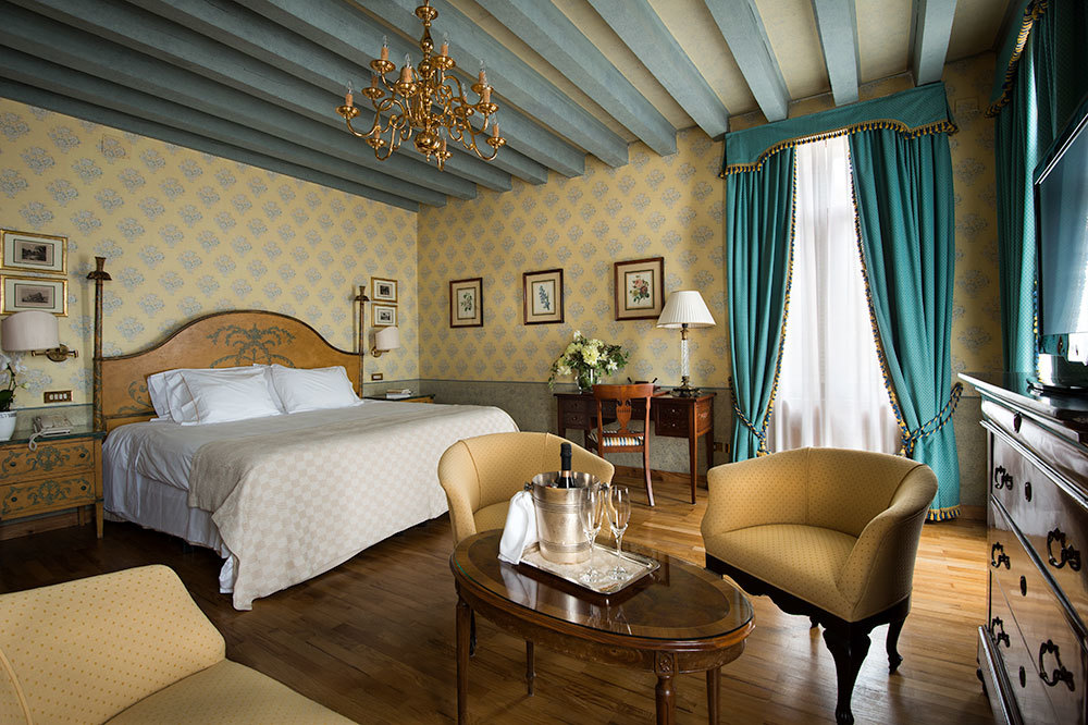 Grand Deluxe Junior Suite with exposed beam ceilings at Hotel Villa Cipriani in Veneto, Italy