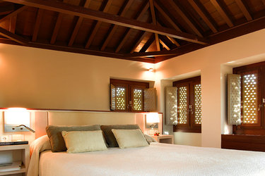Guset room with wood vaulted ceiling at Parador de Granada in Andalusia, Spain