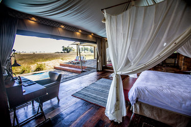 The interior and view from a guest tent at Duba Plains Camp in Duba Plains Reserve, Botswana