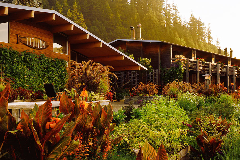 Guest wing and terrace surrounded by green at Tu Tu' Tun Lodge in WesternOregon
