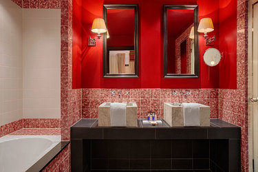 The Junior Suite bath in primary red at Hotel Des Indes, a Luxury Collection Hotel, in The Hague, Netherlands