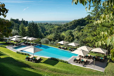 Outdoor pool on the hillside slope at Hotel Villa Cipriani in Veneto, Italy