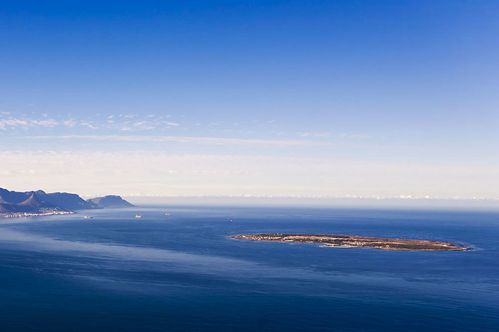The view of Table Mountain, left, and Robben Island, right, in Cape Town