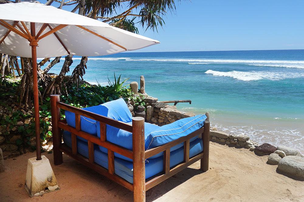 A lounge chair with a view of the ocean at Nihi Sumba on Sumba Island, Indonesia