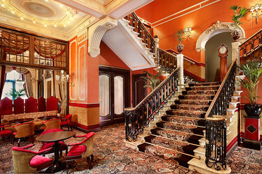 The lounge and staircase at Hotel Des Indes, a Luxury Collection Hotel, in The Hague, Netherlands