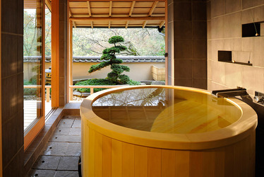 The wooden bath of a room at Gora Kadan in Hakone, Japan