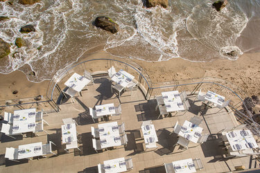 Terrace dining overlooking shore at Malibu Beach Inn in Malibu, California.