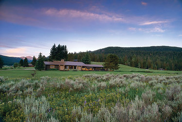 The lodge at dusk at Firehole Ranch in Western Yellowstone, Montana