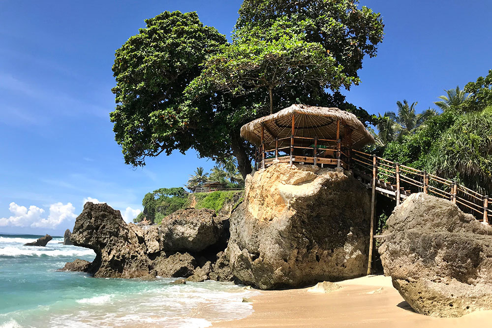The view of the spa pavilion from the beach at Nihi Sumba on Sumba island, Indonesia
