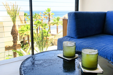 Chilenito cocktails on the balcony of the Ocean View Room at Chileno Bay Resort in Los Cabos, Mexico