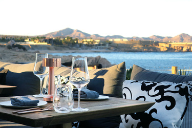 Outdoor seating overlooking the ocean at COMAL at Chileno Bay Resort in Los Cabos, Mexico