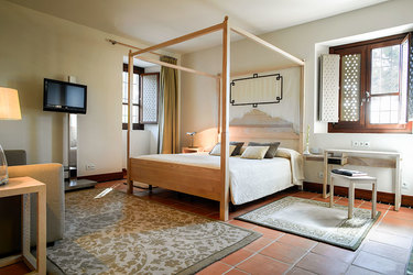 Guest room with canopy bed at Parador de Granada in Andalusia, Spain