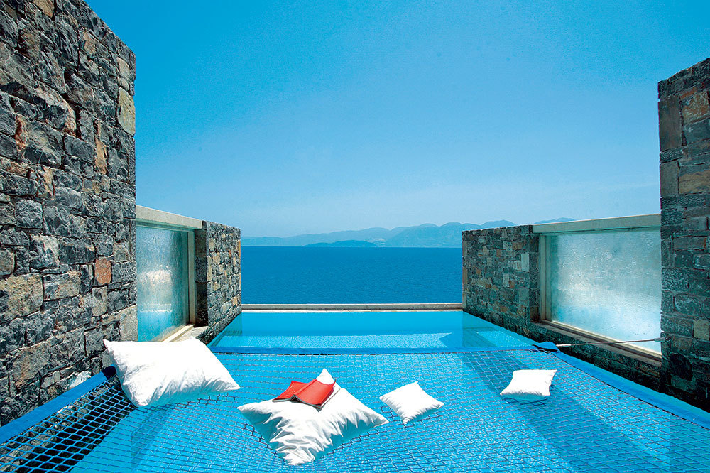 Hammock Above A Pool With View At Elounda Peninsula All Suite Hotel In Crete