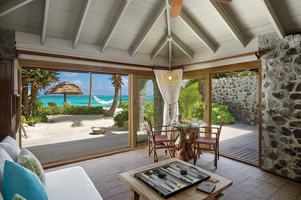 The living room of a One Bedroom Cottage at Petit St. Vincent on Petit St. Vincent Private Island, Saint Vincent and the Grenadines