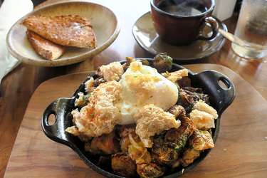 Poached egg with brussels sprouts, chicharrones, and bacon-onion jam from Friday Harbor House in Friday Harbor, Washington