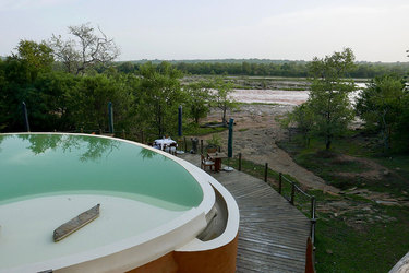 The pool with view of Rufiji River, at Azura Selous in the Selous Game Reserve, Tanzania