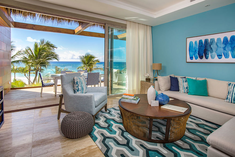 The Beachfront Two Bedroom Suite living area at Eden Roc at Cap Cana