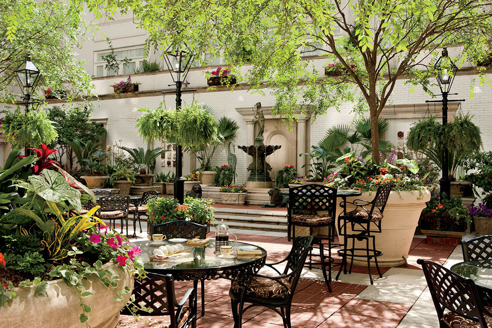 Garden terrace with fountain at The Ritz-Carlton's Maison Orleans in New Orleans, Louisiana