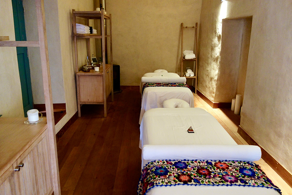 Massage tables in a treatment room at the Spa Pumacahua Bath House at explora Valle Sagrado in the Sacred Valley, Peru