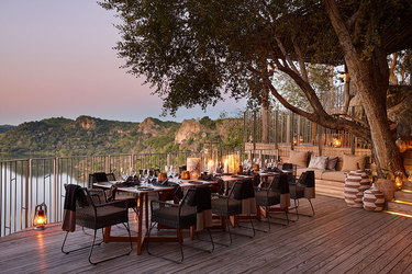 Evening dining on deck at Singita Pamushana Lodge in Malilangwe Wildlife Reserve, Africa