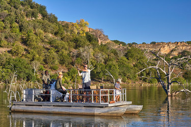 Boating and fishing at Singita Pamushana Lodge in Malilangwe Wildlife Reserve, Africa