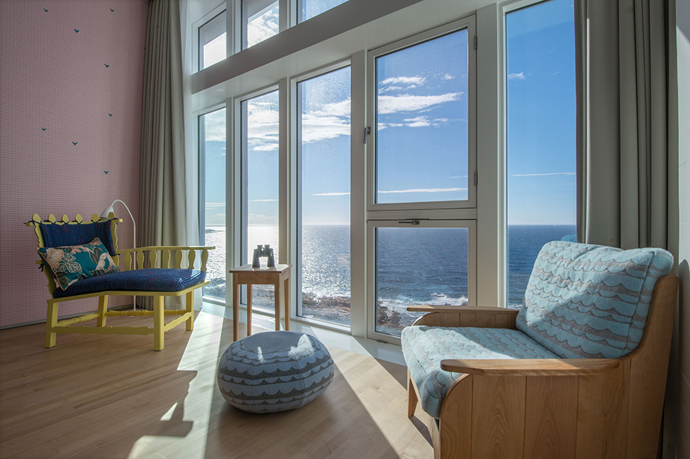 The sitting area of a Newfoundland suite at Fogo Island Inn on Fogo Island, Newfoundland, Canada