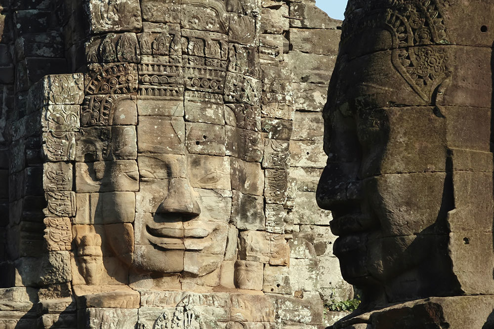 Smiling faces carved to look like Jayavarman VII at the Buddhist Bayon shrine in Siem Reap, Cambodia