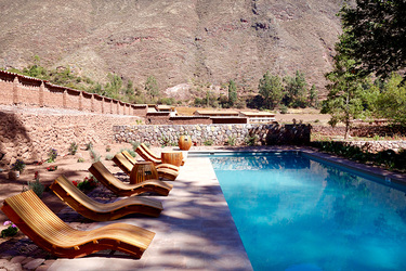 The outdoor pool of the Spa Pumacahua Bath House at explora Valle Sagrado in the Sacred Valley, Peru